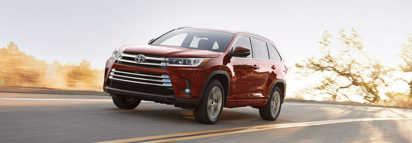 A 2018 Toyota Highlander driving down an open road