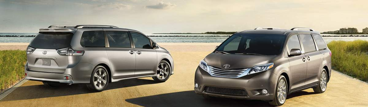Two 2017 Toyota Sienna's parked at the beach