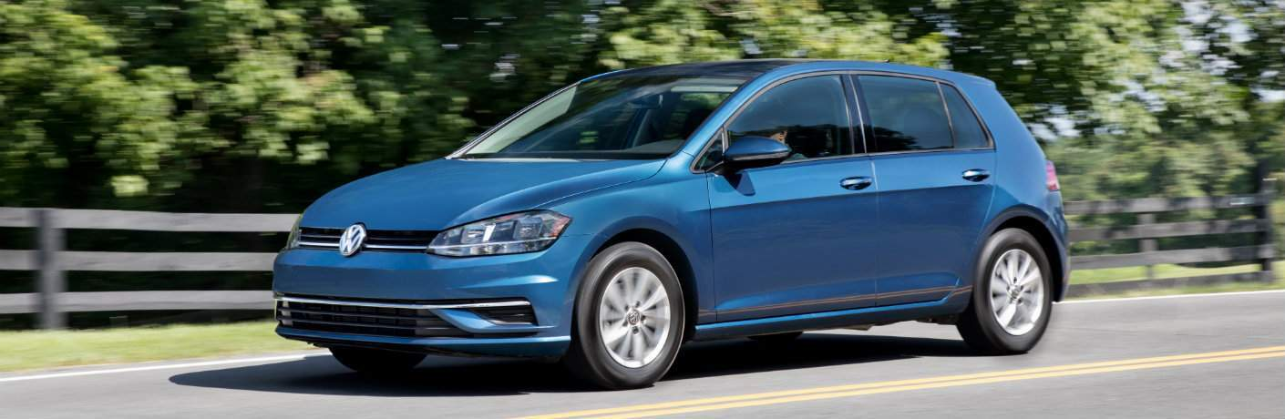 2018 Volkswagen Golf driving near country fence