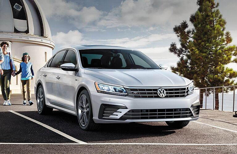 2019 Volkswagen Passat exterior shot with gray silver paint color parked outside an observatory