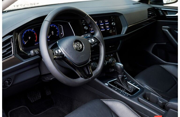 2019 Volkswagen Jetta interior driver's seat view angle of steering wheel, transmission, and dashboard