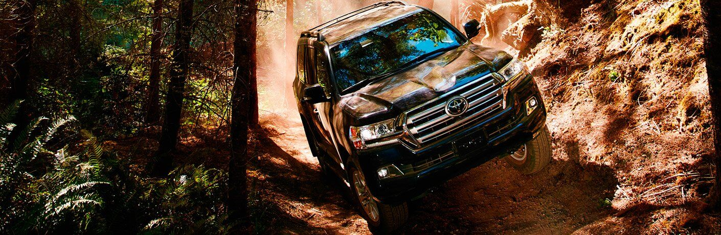 2017 Toyota Land Cruiser driving through rough terrain in wilderness