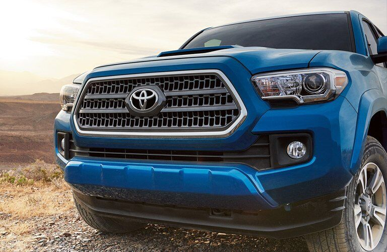 blue 2017 Toyota Tacoma front grille closeup