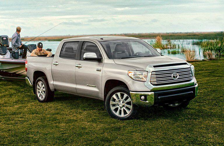 2017 Toyota Tundra hooked up to fishing boat near water