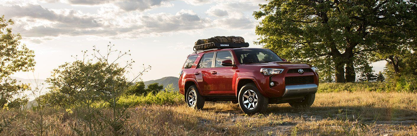 red 2017 Toyota 4Runner in wilderness clearing