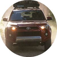 red 2017 Toyota 4Runner with gear on top exterior front