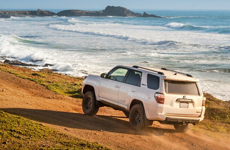 white 2017 Toyota 4Runner driving on a beach