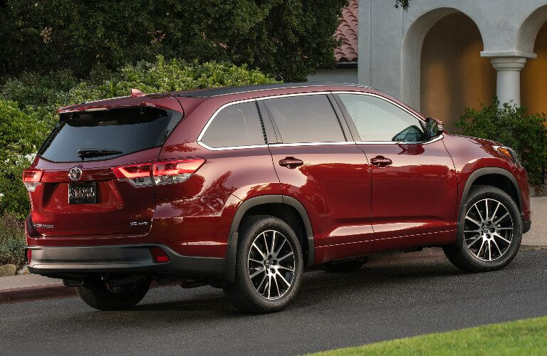 red 2017 Toyota Highlander parked in driveway exterior rear