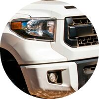 white 2017 Toyota Tundra front grille and headlight closeup