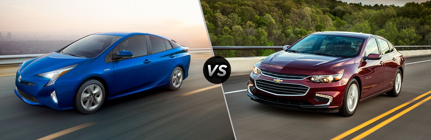blue 2018 Toyota Prius and red 2018 Chevy Malibu Hybrid side by side