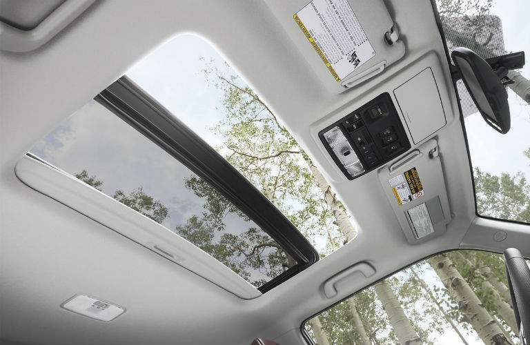 2018 Toyota 4Runner interior front cabin looking up at open sunroof