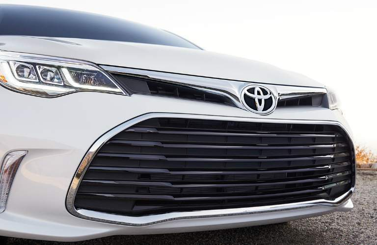 closeup of front grille on white 2018 Toyota Avalon Hybrid