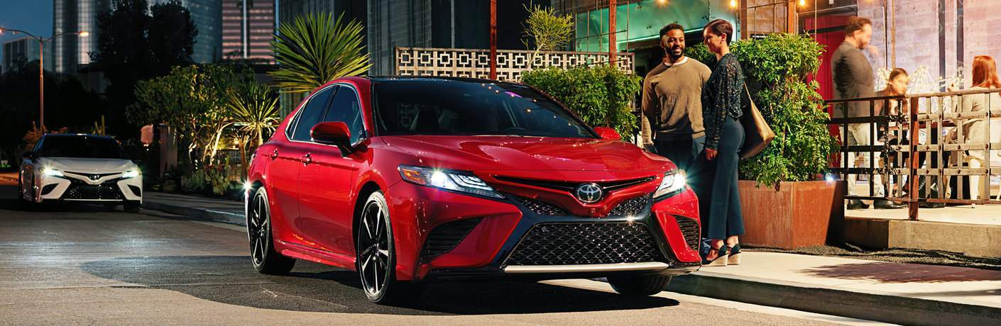 red 2018 Toyota Camry parked at night exterior front view