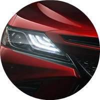 red 2018 Toyota Camry headlight closeup