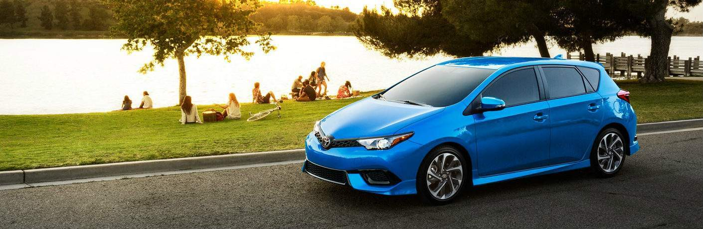 blue 2018 Toyota Corolla iM parked near lake