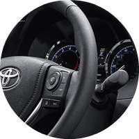 closeup of 2018 Toyota Corolla steering wheel and instrument cluster