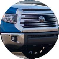 closeup of grille and headlight on 2018 Toyota Tundra
