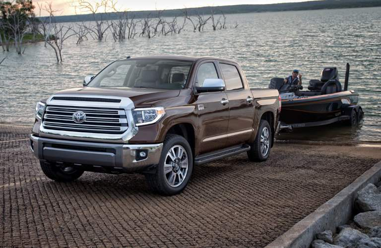 2018 Tooyota Tundra pulling boat and fisherman out of water on trailer