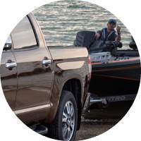 closeup on boat and man being pulled from water by 2018 Toyota Tundra