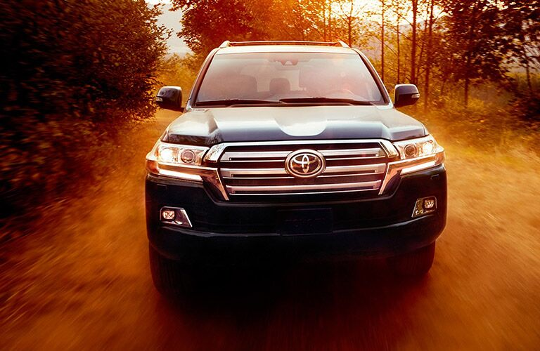 2019 Toyota Land Cruiser exterior front fascia going fast on wooded road