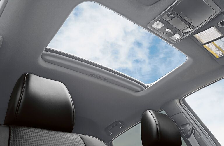 Interior view of the open sunroof inside a 2019 Toyota Tacoma