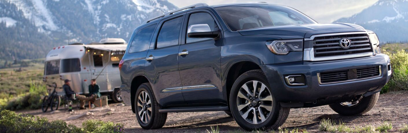 2019 Toyota Sequoia exterior front fascia and drivers side with camper and people in background