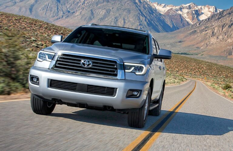 2019 Toyota Sequoia exterior front fascia and drivers side on road with mountains in background