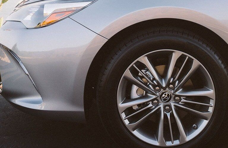 silver 2017 Toyota Camry wheel and headlight closeup