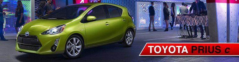 yellow 207 Toyota Prius c front side view