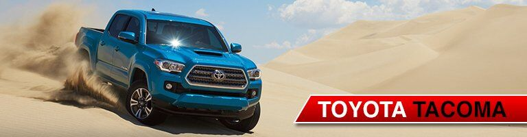 blue Toyota Tacoma driving off road