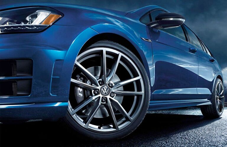 2018 Volkswagen Golf R exterior below angle close up of blue coat paint frame and turning wheel and tire