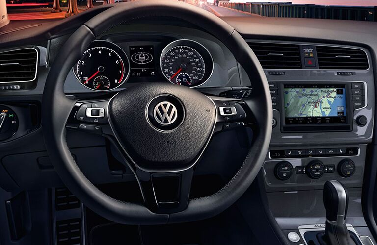 2018 Volkswagen Golf Alltrack closeup of steering wheel, transmission, and infotainment dashboard