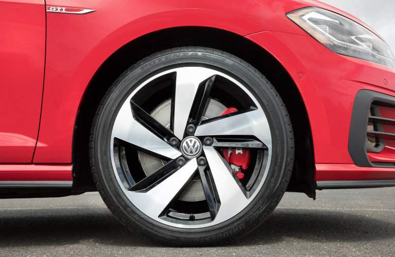 2018 Volkswagen Golf GTI exterior shot close up of front tire, grille, and right headlight