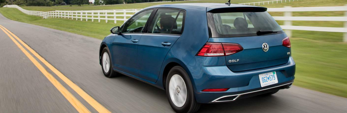 2018 Volkswagen Golf back shot driving by country fence