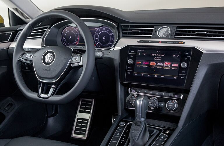 2019 Volkswagen Arteon interior shot of driver's seat view of steering wheel, transmission, and dashboard infotainment screen