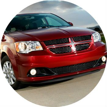 Red Dodge Grand Caravan front grille