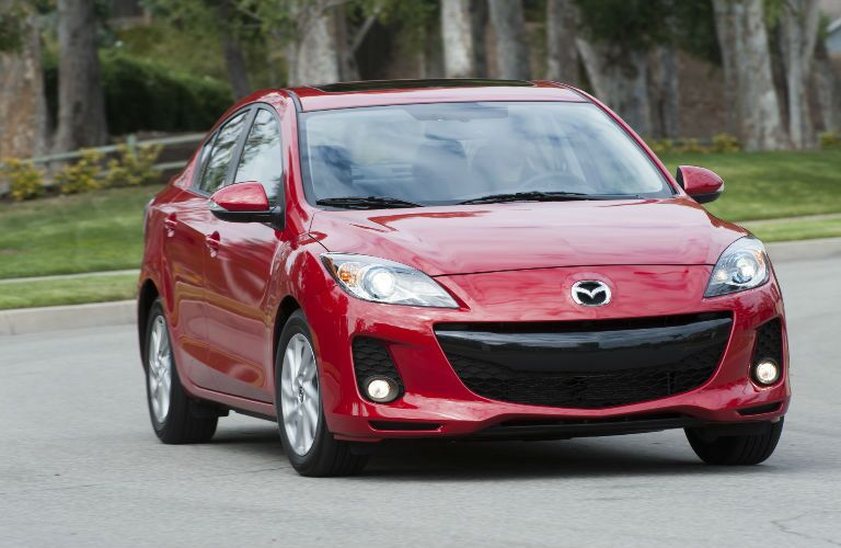 red Mazda 3 driving