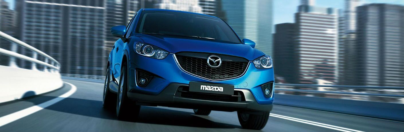 Blue Mazda CX-5 on freeway