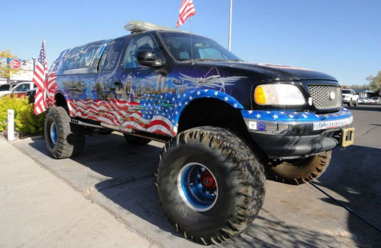 2001 Ford F-150 XL with American flag design and oversized tires