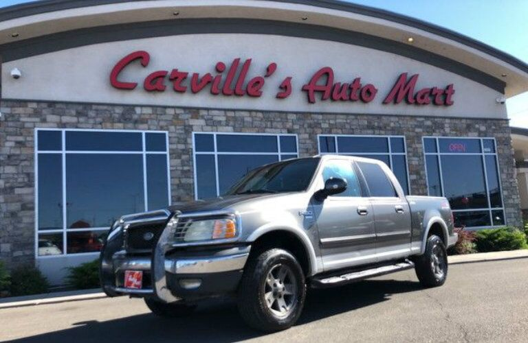 2002 Ford F-150 Lariat with grille bumper at Carville's Auto Mart