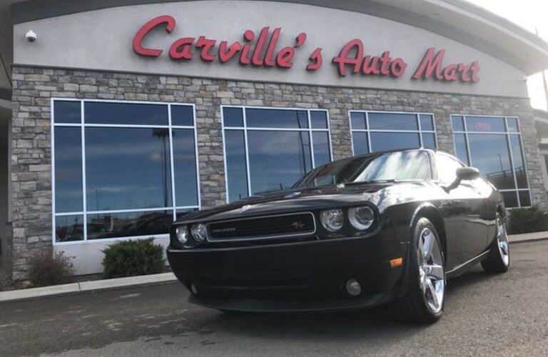 2009 Dodge Challenger parked outside Carville