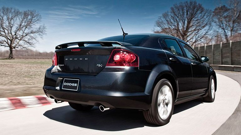 2014 Dodge Avenger speeding down the road