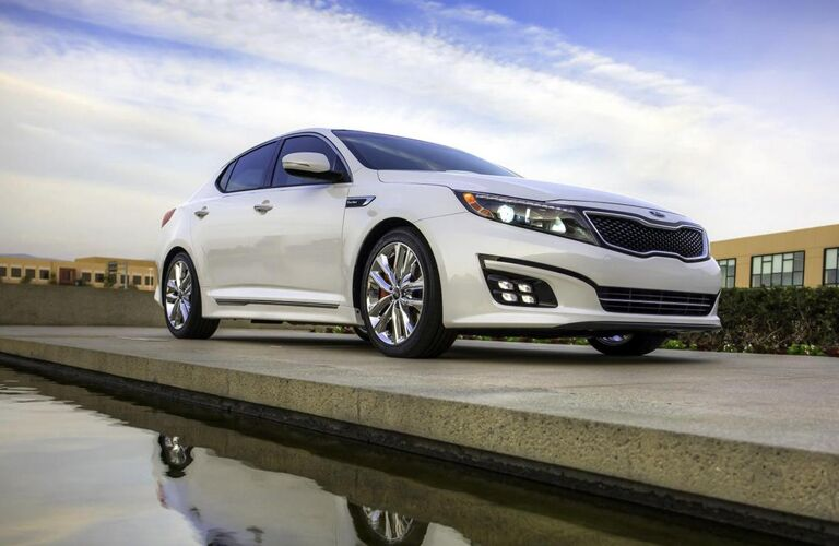 2015 Kia Optima parked by some water