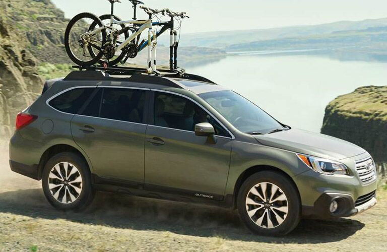 Subaru Outback carrying bike on roof racks