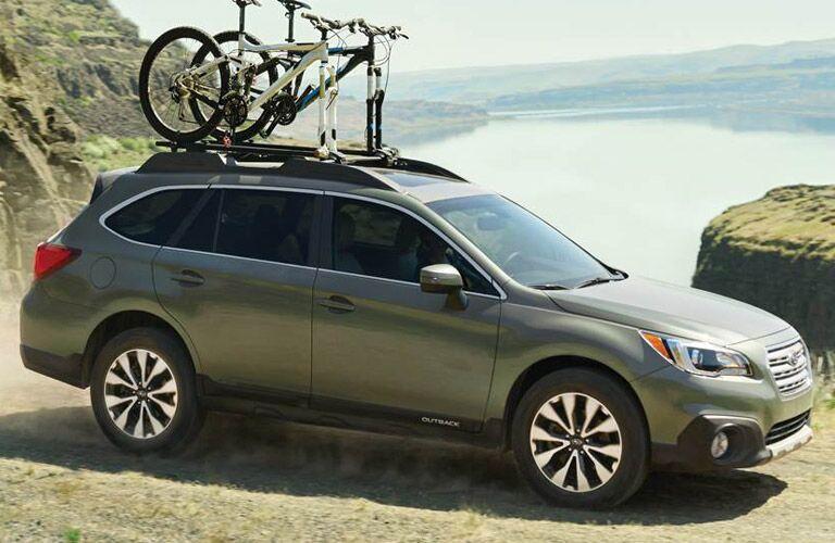 Subaru Outback carrying bike on roof racks