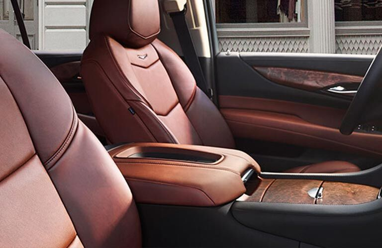 Front seats and center console of 2018 Cadillac Escalade with center console prominent