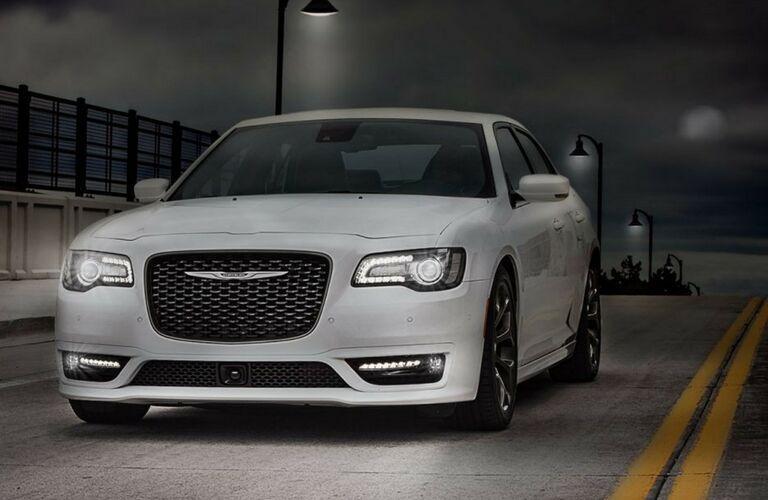 White Chrysler 300 driving on dark night road