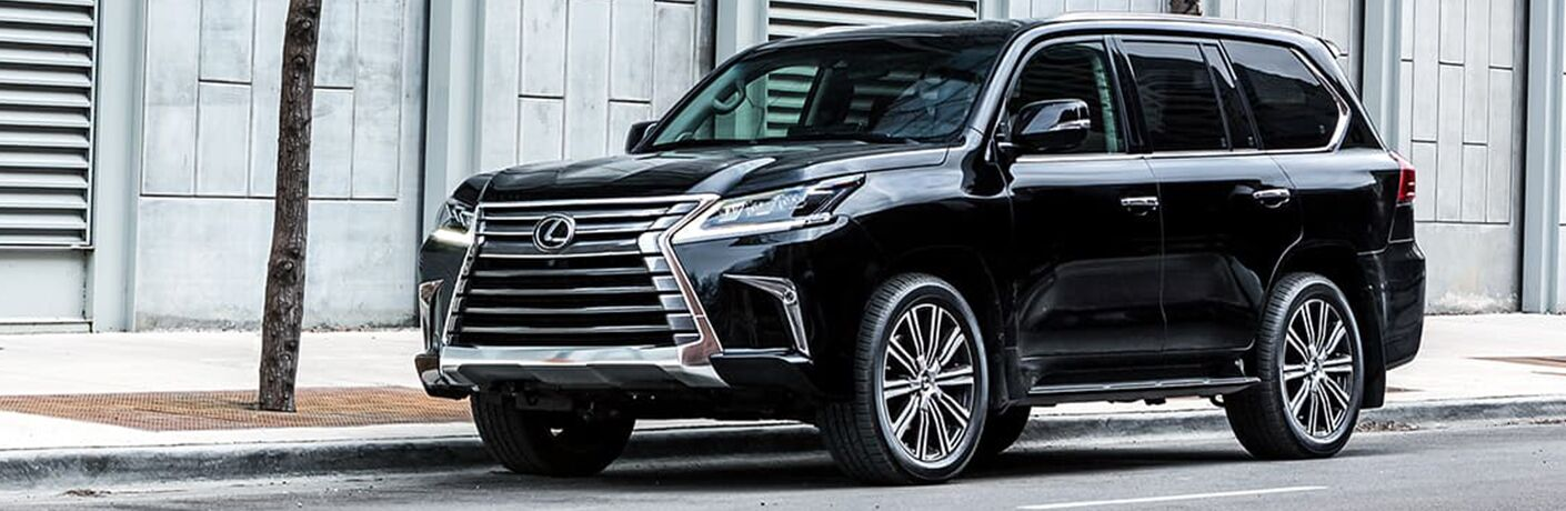 Black 2019 Lexus LX parked on city curb