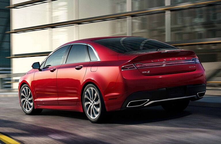 Rear shot of red 2019 Lincoln MKZ parked in front of modern building