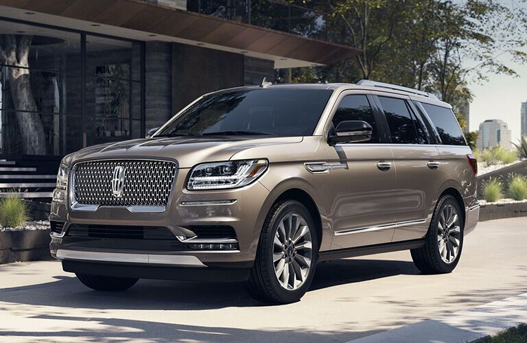 Beige 2019 Lincoln Navigator parked in driveway in front of house
